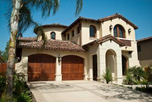 attractice two story home with wooden garage doors
