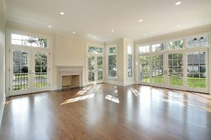 living room with wood floors and glass doors